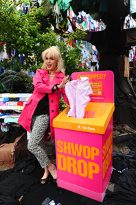 Joanna Lumley posing with a Shwop drop clothes collection bin