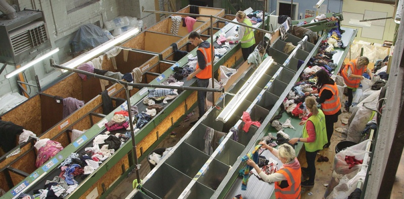 Textiles being hand sorted for recycling