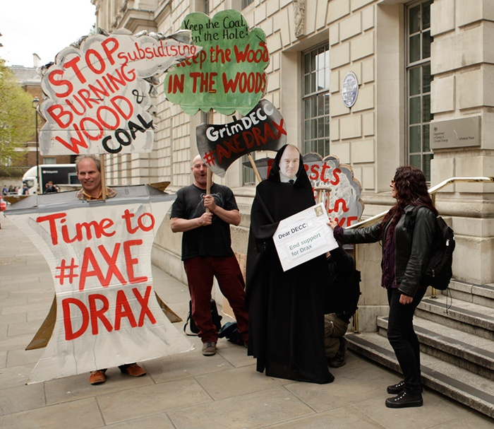 Protestors give Ed Davey 'Grimm Reaper of Forests' anti-biomass letter