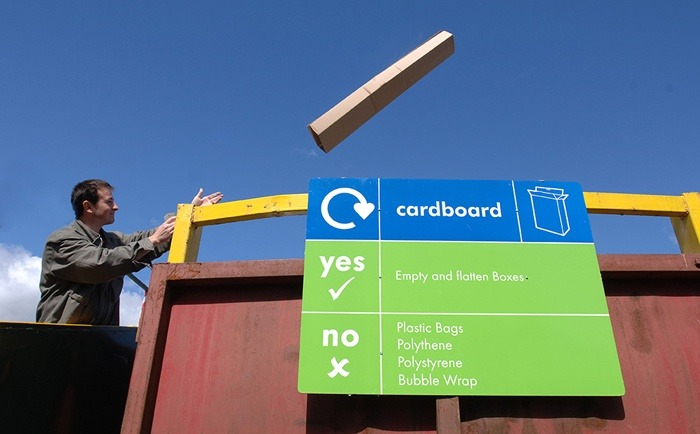 A resident deposits waste at a Household Waste Recycling Centre