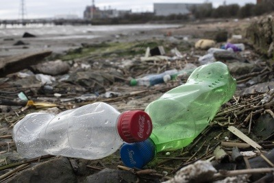 Coca-Cola bottles washed up on the shore