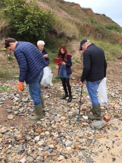 Employees involved in a litter pick on the beach