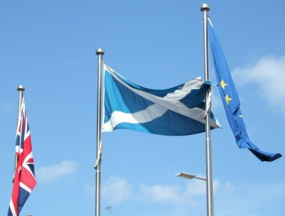 British, Scottish and EU flags outside Parliament