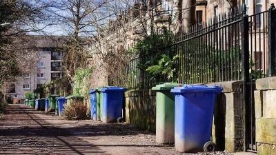 An image of wheelie bins along a street