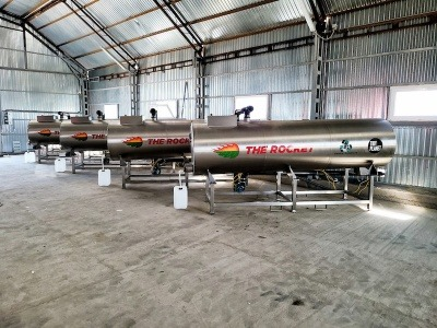 Four Tidy Planet rocket composters in a warehouse