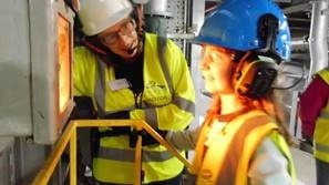 Jessica Baker-Pike showing a young visitor the EfW combustion chamber