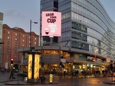 A #GrabYourCup poster in Manchester