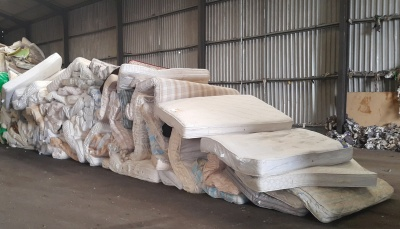 Pile of mattresses ready for recycling