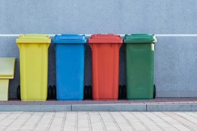 Four multicoloured bins, from left to right – yellow, blue, red, and green