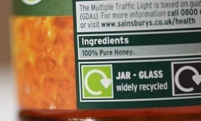 A jar of honey with an on-pack recycling label