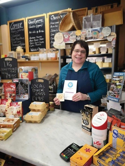 A cafe owner in Llangollen who was accredited with a plastic free mark