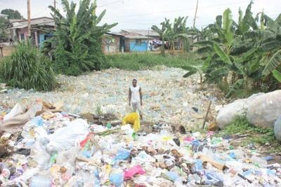 Man in sea of plastic pollution