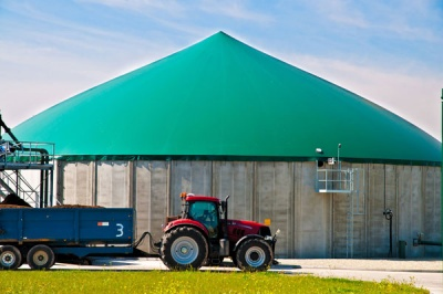 Image of a tractor in front of an anaerobic digestion (AD) plant