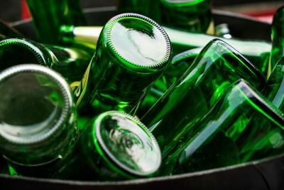 An image of green glass bottles