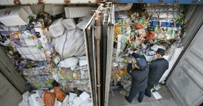 Customs officials inspect waste in Guangzhou