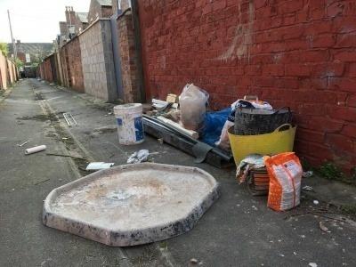Dumped waste in a side street.
