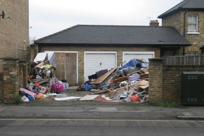 Mounds of fly-tipped waste outside garages in North London