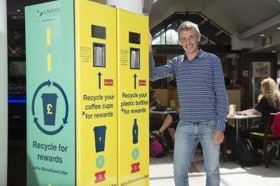 Hubbub's Trewin Restorick with two of the recycling reward machines in Leeds
