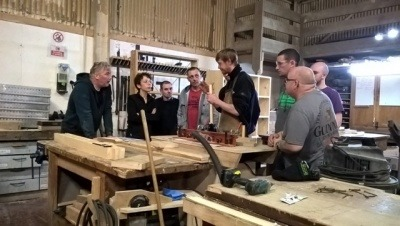 Employees at the Glasgow Wood Recycling workshop