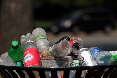 Image of cans, glass and plastic bottles in a bin