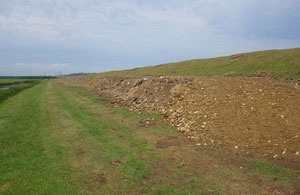 Waste company fined for using waste as flood defence