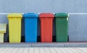 Four bins, from left to right – yellow, blue, red, and green