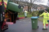 A Biffa employee collects bins.