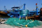 DuraOcean® chair in front of fishing boat.