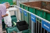 A resident sorting waste at an HWRC