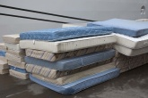 A pile of old mattresses.