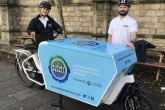 Two operatives with an e-bike from Putney Pedals