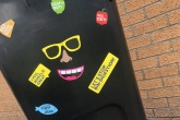 A bin with bin stickers on it.