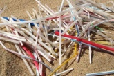 Plastic straws on a beach