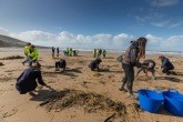 Volunteers taking part in a beach clean