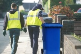 Waste workers removing bins