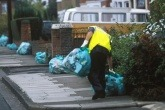 Man picking up kerbside residual bags.