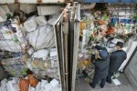 Customs officials in Guangzhou inspect waste imports