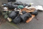 Pile of household and building waste fly-tipped at Haigh Park, Stockport