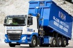 A white and blue URM lorry