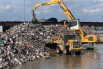 Crane moving metal recycling