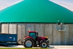 Image of a tractor in front of an anaerobic digestion facility