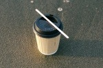 An image of a paper coffee cup on the ground