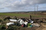 Waste illegally dumped on a piece of land