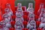 Empty glass bottles in a red crate
