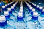 An image of plastic bottles of water
