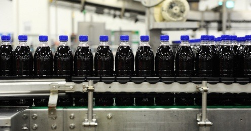 Plastic bottles being manufactured