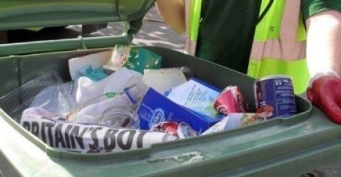 Recycling in a bin
