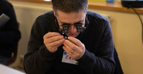 A volunteer fixing an item at a repair café