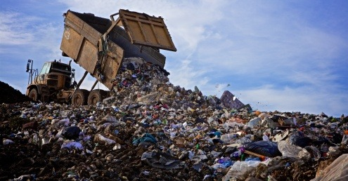 A truck disposing of residual waste in a landfill site.