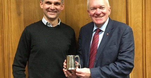 Andy Doran (Chairman) presenting Ray Georgeson with an engraved tankard